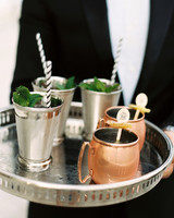 metallic silver and copper cups on tray