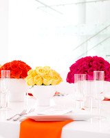 Bright orange, yellow and red rose centerpieces