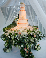 large wedding cake on floral base