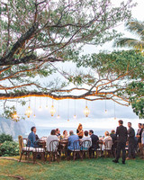 rebecca eryck wedding hawaii reception table tree lights guests