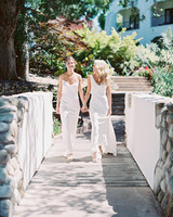brides walking across bridge