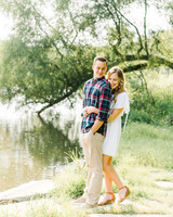 couple hugging under tree engagement photo