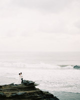 vivi yoga bali wedding ceremony couple ocean rocks