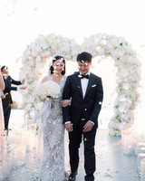 angie prayogo greece wedding recessional petals couple arch