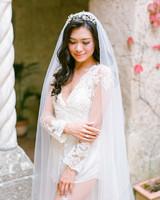 bride wearing statement crown and veil