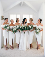 chic bridesmaids split front white gown with gold heels