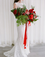 colleen stephen newport wedding bride with bouquet with red ribbon