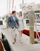 colleen stephen newport wedding couple walking on boardwalk