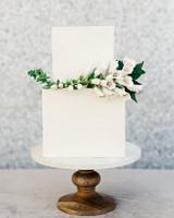 cubed wedding floral arrangement on simple white cake