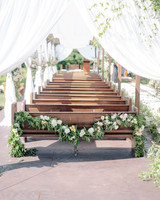 last row ceremony chair decorations roses and greenery garland