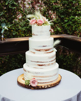 semi naked wedding cake with fresh floral topper