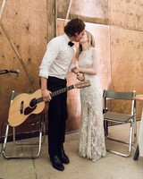 wedding couple kissing groom holding guitar