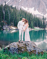 Bride and Groom Posing by Mountains and Water