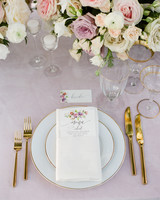 table place setting gold rimmed plates gold flatware