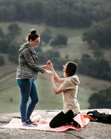 perfect proposals hiking hill top with pink blanket