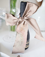 ribbon wedding ideas ribbon tied around mini champagne bottle