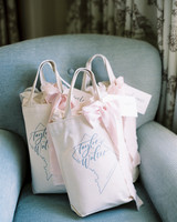 ribbon wedding ideas pink ribbon tied to welcome bags