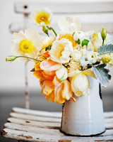 rustic wedding centerpieces enamel water jug orange flowers
