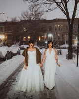 brides on snowy street