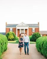 couple walking on estate engagement photo