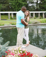 couple by pond and flowers engagement