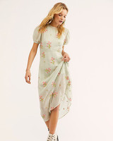 pale green midi dress with puffed sleeves and pink floral print