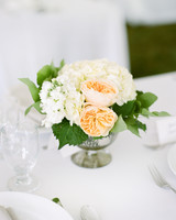 Vintage white hydrangea and garden rose centerpiece