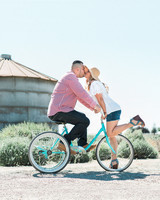 couple kiss on bicycle engagement photo