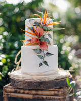 tropical wedding birds of paradise flower on white cake