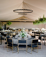 whitney zach wedding dinner round tables gold chairs