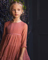 winter flower girl dusty pink dress with three-quarter sleeves and gold stars