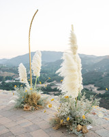 golden arch with pampas grass
