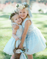 flower girls hugging