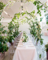 texas wedding greenery arch long tables