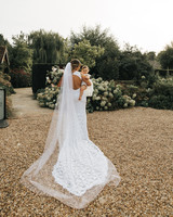 bride holding baby