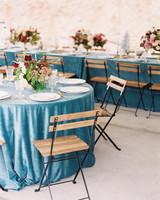 surprise wedding reception tables blue tablecloths