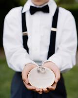 ring bearer holding decorative dish at wedding