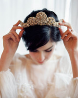 bride wearing traditional gold-and-diamond crown