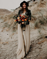 bride wearing black hat and jacket