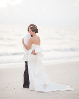 A Bride with a Wedding Dress Featuring a Ruffle Train