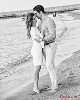 couple hugging on beach outdoor engagement photos