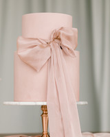 ribbon wedding ideas pink ribbon tied around pink wedding cake
