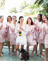 bride with mothers and bridesmaids in pink satin robes