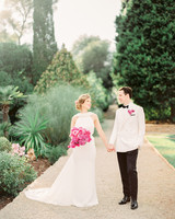 stephanie nikolaus wedding couple holding hands