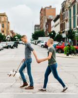 couple walking street with dog engagement photo