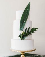 Three Tiered White Cake With Tropical Leaves