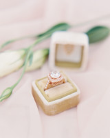 engagement rings round cut stone with square halo setting
