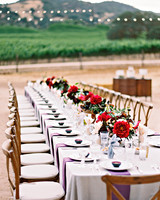 Long Reception Table with Red Floral Arrangements