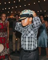 boy wearing boating hat dancing