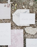 white stationary suit with gray and pink marble accents and calligraphy